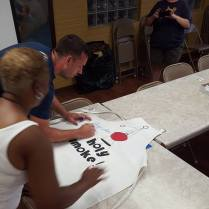 signing the apron. . .leave room for next year!